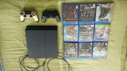 Ps4 1TB console + 2remotes + 8games