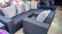 L-shaped and a single sitting room chairs made of quality materials.