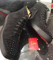 Black hightop Christian Louboutin sneakers