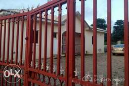Distress sale:A 4 Bedroom detached bungalow with a room and parlor BQ