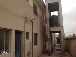 A 21 room hostel accomodation with 3 shops on a standard plot of land.