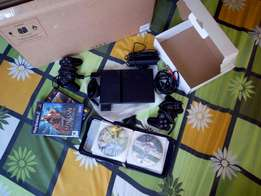 Playstation 2 perfect condition with 22 games,sd carD, 2 joysticksFREE