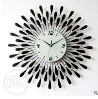 New design s movement wall clocks of different colours.