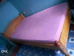 Quick sale 3.5 by 6 Wooden strong bed and a high density mattress