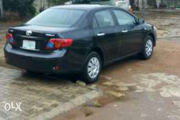 A standard toyota corolla 09 is available for sale