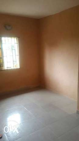 Standard and spacious 300k with 3t at igando facing a tarred rd Ikotun - image 4