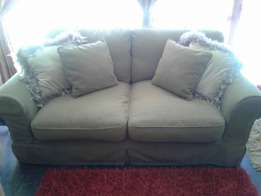 As new stained proof Coricraft couch for sale