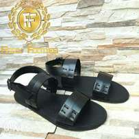 Black leather sandals styled with muxon thread