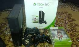 XBOX 360 500 gig.2 Controllers.5 Games 1 Charging kit.