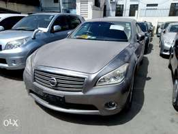 Gray Nissan fuga 370 gt with sunroof