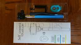 New Selfie Sticks for sale with Bluetooth Remote Shutter!!
