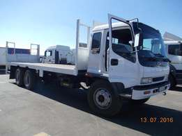 Isuzu 12 ton flat deck for sale in immaculate running condition.