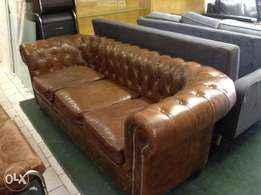 Brand new brown leather chesterfield couch