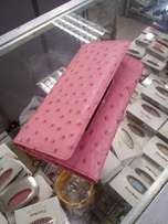 Brand new Pink Busby Genuine Ostrich leather purse.