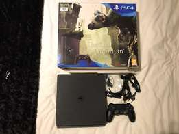PS4 Slim 1TB good as new