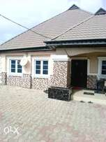 4bedroom Bungalow tiles, POP, borehole interlock on a plot land.