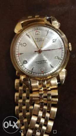 Tell gold women's watch 18 k with a gold Rolex strap
