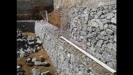 Mesh wire boxes filled up with stones, Retain It Durba
