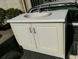 Cupboard with sink and mixer