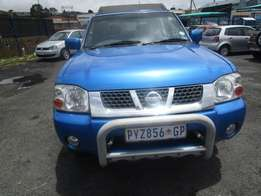 2004 nissan np 300 ,blue in colour , 4 doors ,230 000km ,hard body