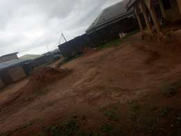Almost half plot of Land 50 by 50 square meter fenced at Baruwa Ipaja