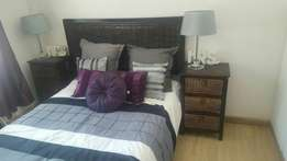 Double bed with headboard, lamps and 2 night stands