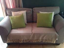 Grey two seater couch with removable cushions