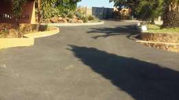 Asphalting roads speed humps and driveways