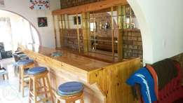 solid pine wood bar, 4.5 m long with 4 chairs