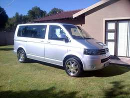 Driver with kombi for hire.