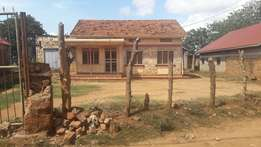 Avery fantastic plot with a house in bweyogerere at 155m on 50x100ft