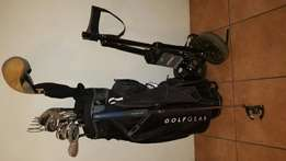 Taylormade Graphite golf clubs and trolley for sale