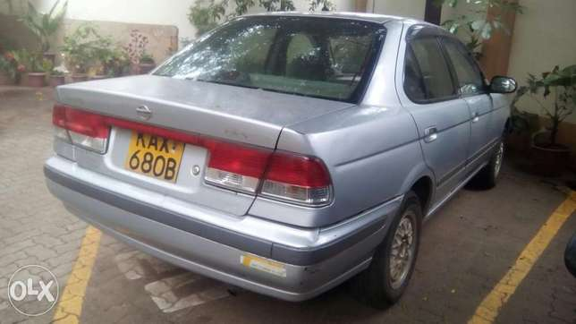 Selling Above Nissan Sunny B15, KAX 680B,Silver in Colour,Very Clean Langata - image 8
