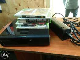 clean used Xbox 360 with one pad and 5games