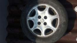 1x peugeot 15 inch mag and tyre R 450