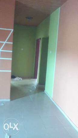 Neat and decent 2bedroom flat up with 3toilets at Igando close to b/s Onilu Village - image 4