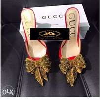Gucci female slipper heels