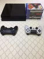 PS4 + 2 controls with 9 games BARGAIN!