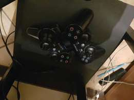 Ps 3 with 19 games for sale plus 2 remotes