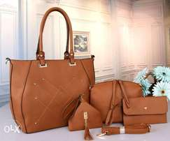 Quality leather made handbag available in different colors.
