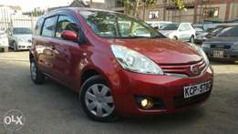 Nissan Note 1500cc 2010 wine red dark interior.