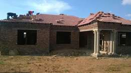 Building plastering and roofing