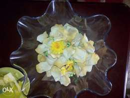 Table glass container for flowers.