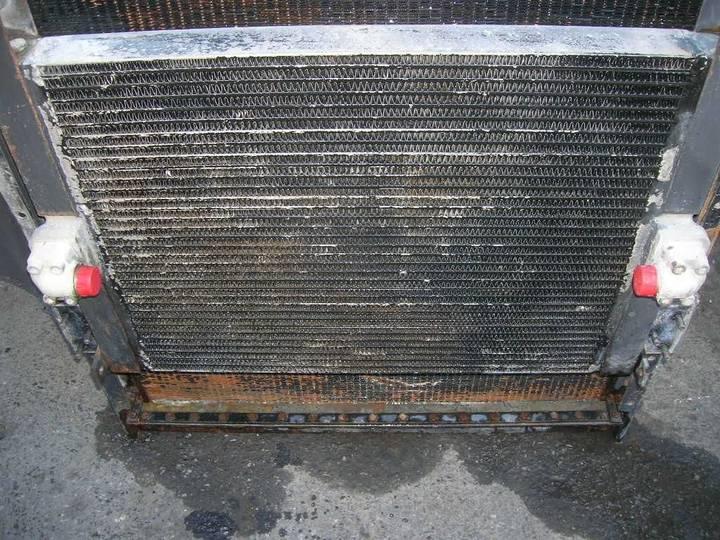 Engine oil cooler for excavator