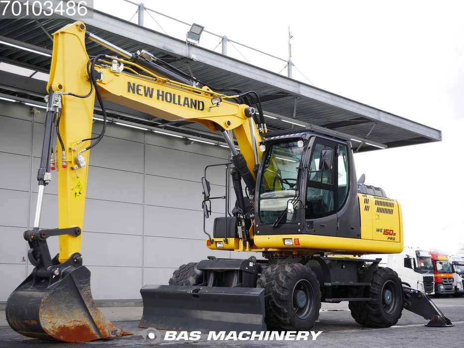 New Holland WE150B PRO Ex demo machine - outriggers and blade - 2015