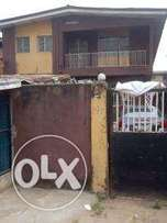 A standard 3bedroom flat in a compound along the road for commercial