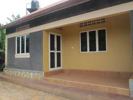 Unique cheap two self contained bed room at 450000 in Kireka lower.