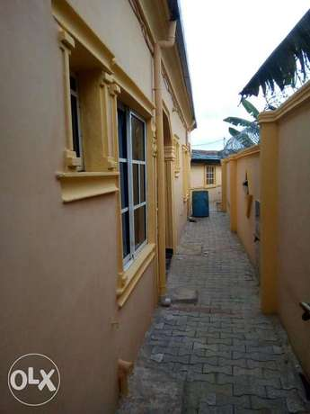 Lovely New 2bedroom flat at Afolabi Along lasu isheri rd 300k with 3t Igando/Ikotun - image 5
