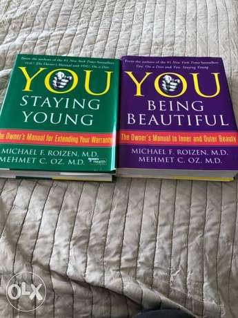 2 books by Michael Poizon and Dr OZ . staying young and staying beauti