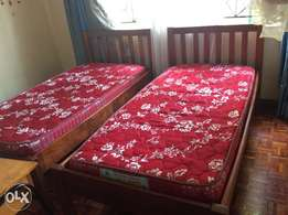 Two beautiful single beds with mattresses